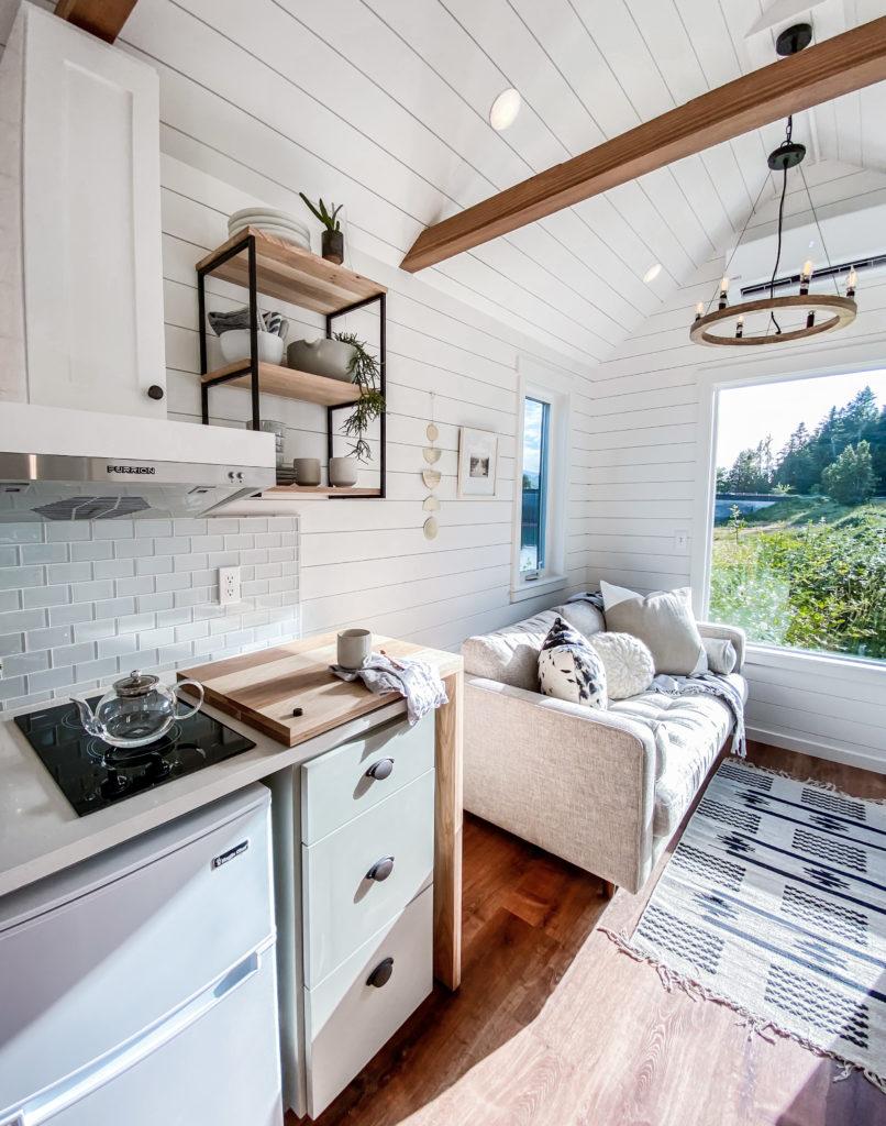 White walls, minimal kitchen tiny dining room